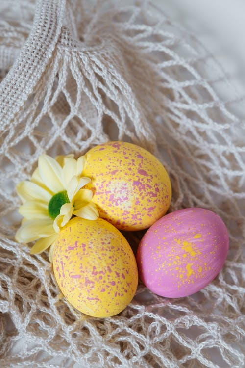 Yellow and Pink Egg on White Knit Textile