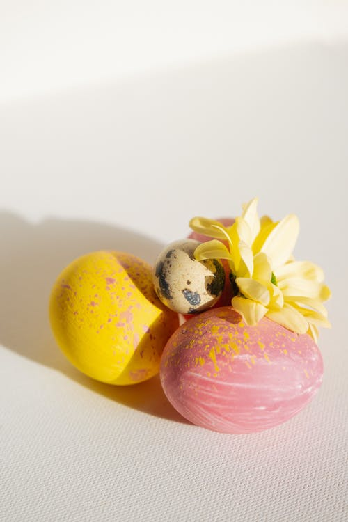 Yellow and Pink Egg on White Table