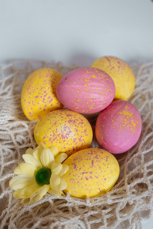 Pink Yellow and Purple Egg on White Textile