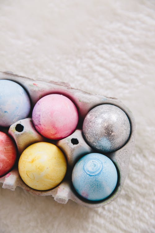 Blue Yellow and Pink Easter Eggs on Gray Egg Tray