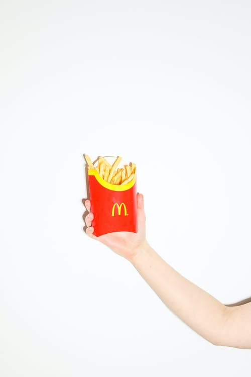 Person Holding Fries