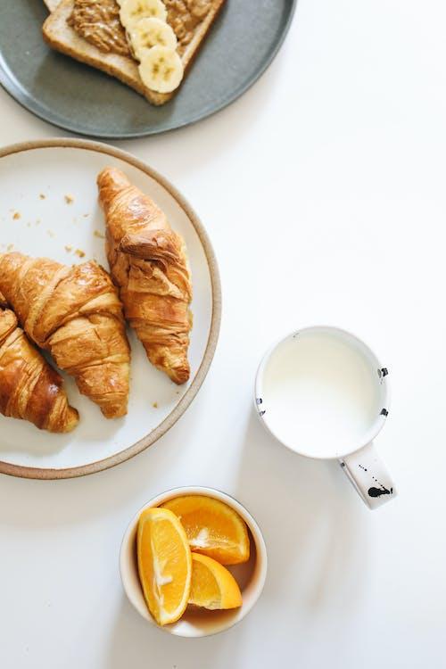 Sliced Bread on White Ceramic Plate Beside White Ceramic Mug