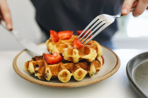 Waffles With Berries On White Ceramic Plate
