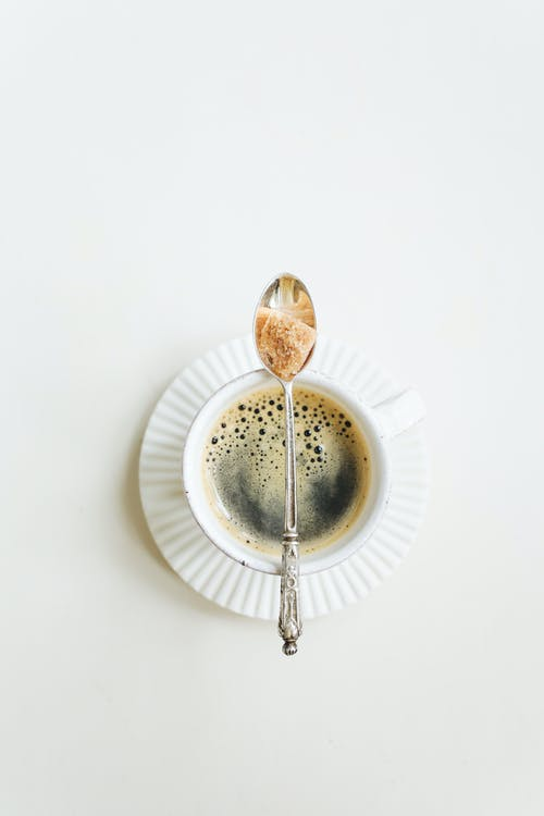 Cup Of Coffee With Saucer And Teaspoon