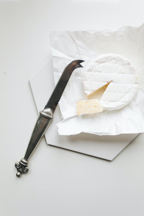 Photo Of Knife Near Camembert Cheese