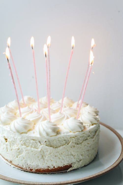 Photo Of White Cake With Candles On Top