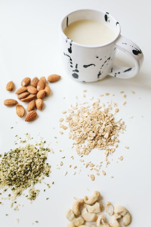 Photo Of Assorted Nuts Near Mug