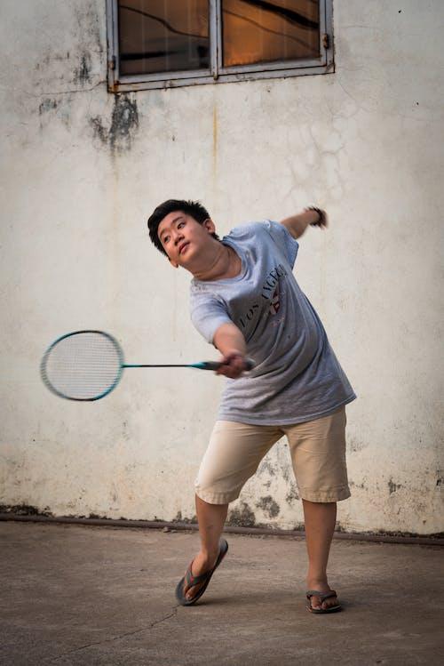 Photo Of Boy Playing Badminton