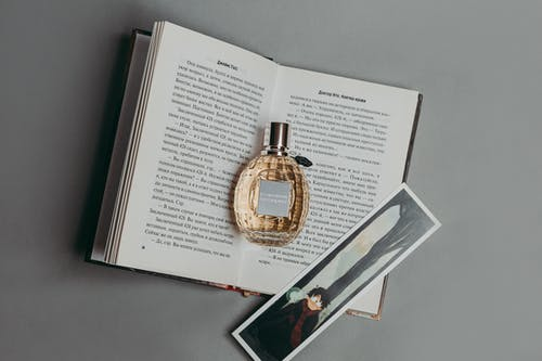Photo Of Perfume On Top Of Book