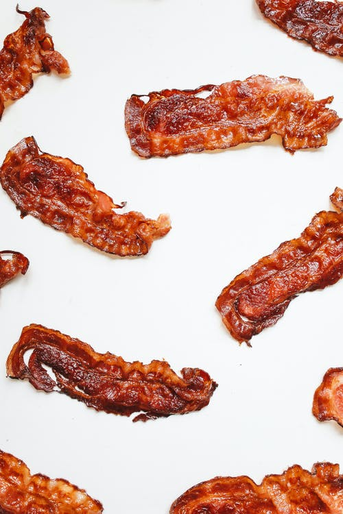 Brown Bacon Strips on White Surface