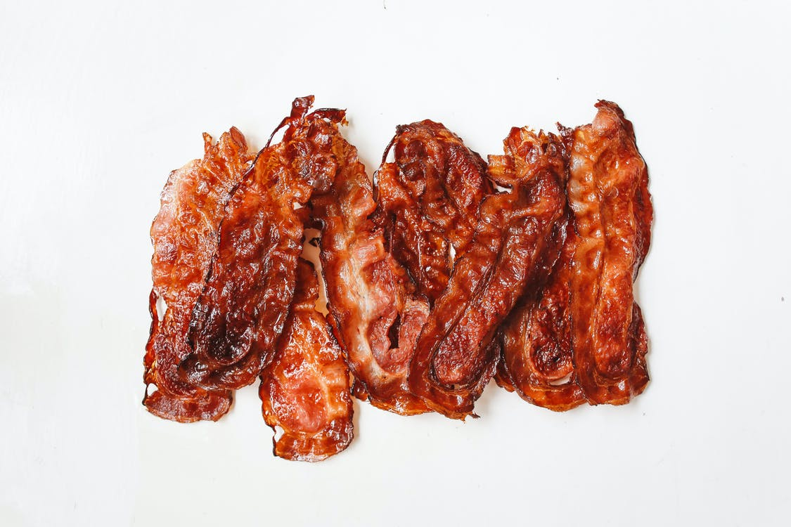 Fried Strips Of Meat On White Surface