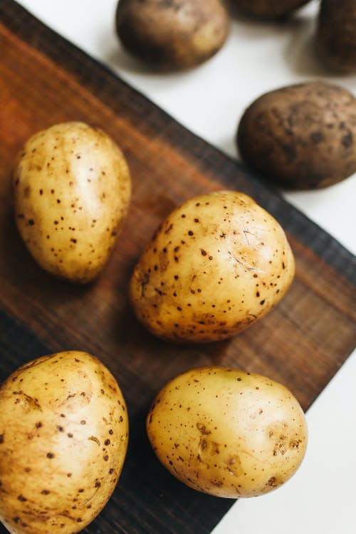 Photo Of Potato On Wooden Surface