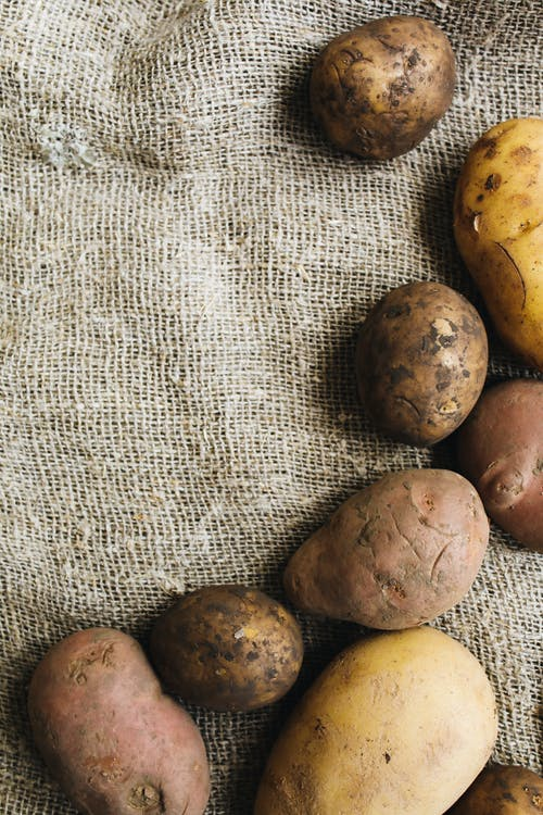 Photo Of Potatoes On Top Of Rice Sack