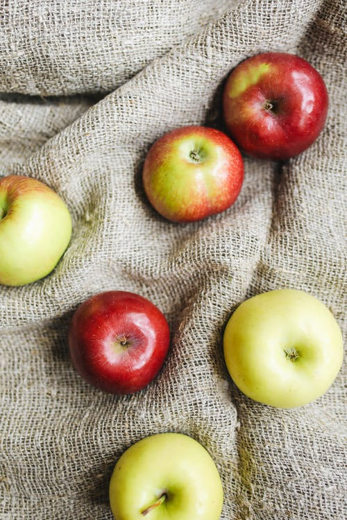 Photo Of Apple On Top Of Rice Sack