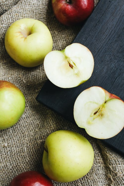 Close-Up Photo Of Sliced Apples On Wooden Surface