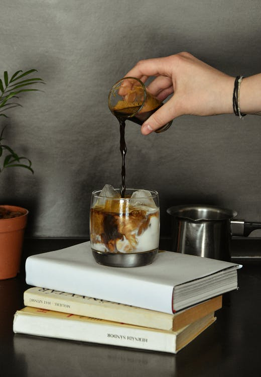 Photo Of Person Pouring Coffee