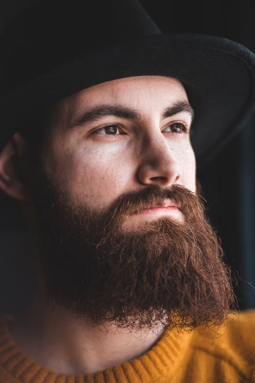 Stylish young bearded man looking away