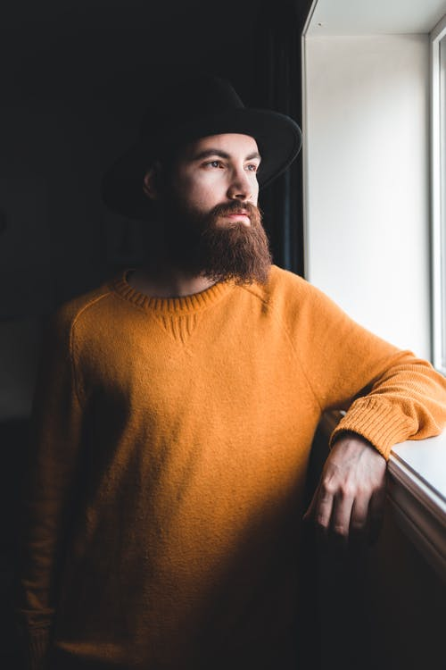 Photo Of Person Wearing Orange Sweater