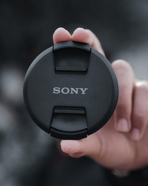 Close-Up Photo Of Black Nikon Camera Lens Cover