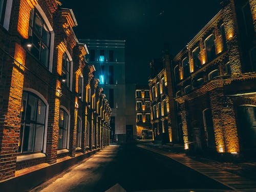 Dark street with brick buildings in old town