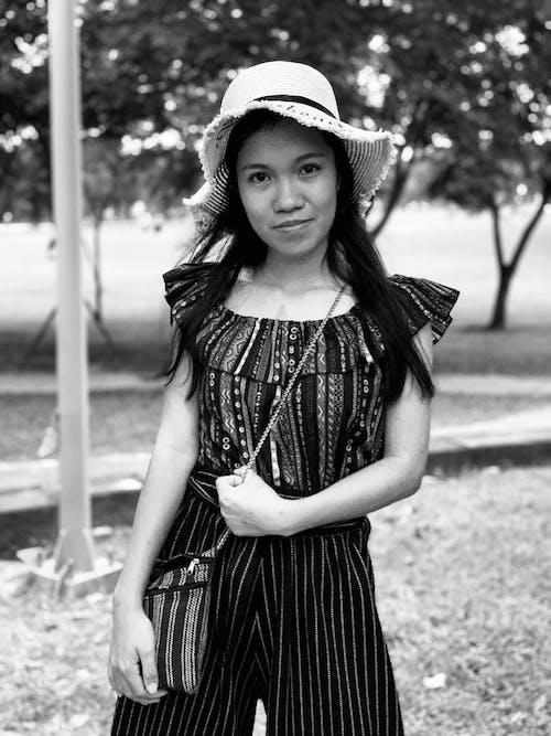 Monochrome Photo Of Woman Wearing Sun Hat