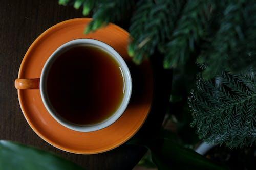 Brown Ceramic Mug With Tea