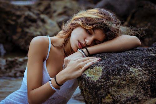 Photo Of Woman Sleeping On Rock