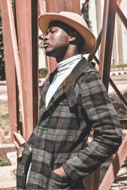 Photo Of Man Wearing Checkered Coat