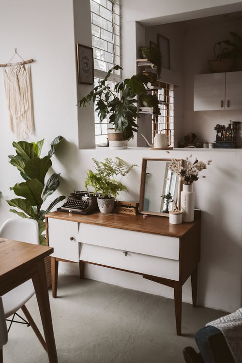 Brown and White Wooden Table With Green Plant