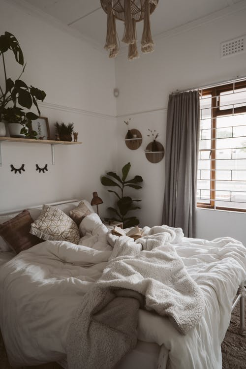 Photo Of Bed Near Window