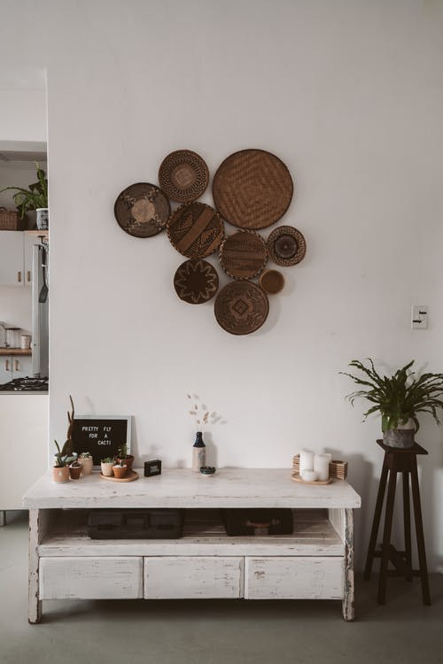 Brown Round Wall Decor on White Wall
