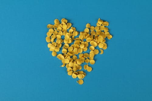 Yellow Confetti On Blue Background