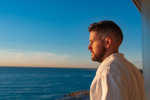 A Man Looking at the Ocean View