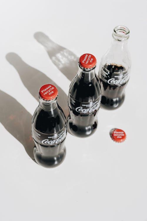 Coca Cola Bottles on White Table