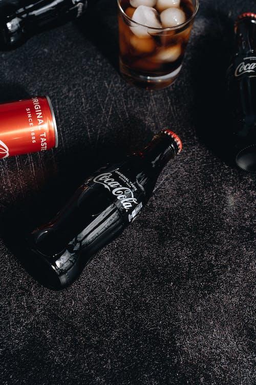 Coca Cola Bottle on Black Table