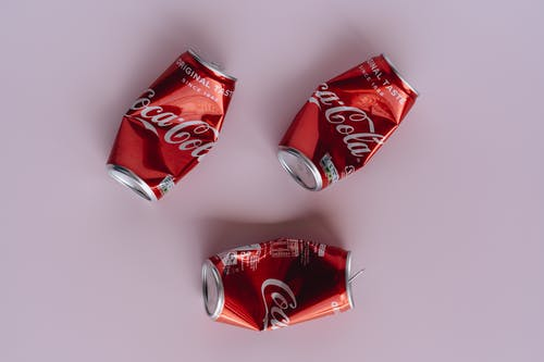 Photo Of Red Crumpled Cans