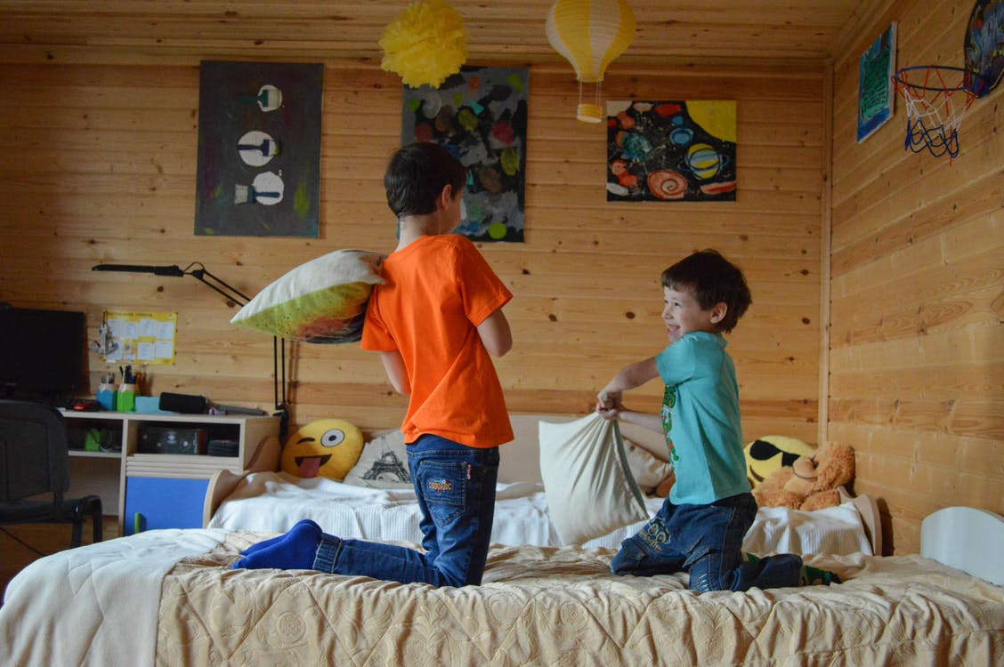 Photo Of Boys Holding Pillows