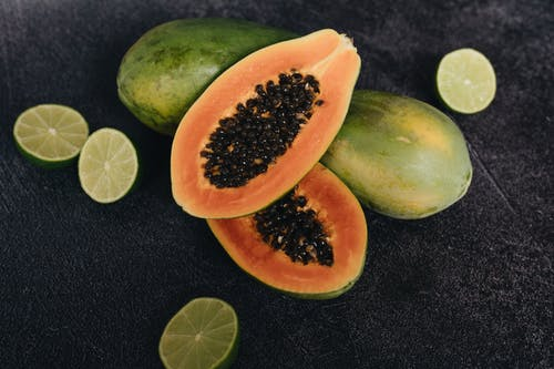 Photo Of Papaya Beside Sliced Lime