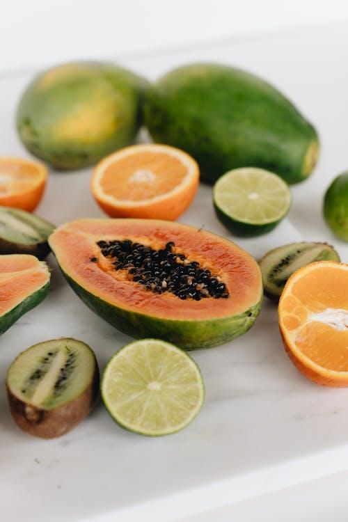 Close-Up Photo Of Sliced Fruits