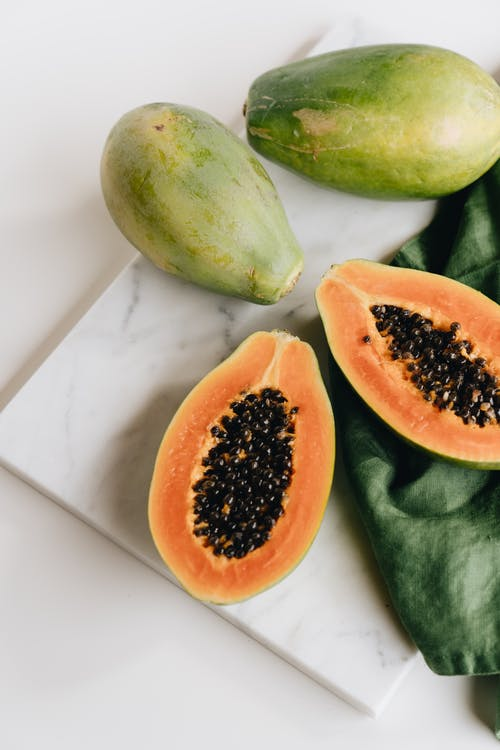 Photo Of Sliced Papaya On Top Of Marbled Surface