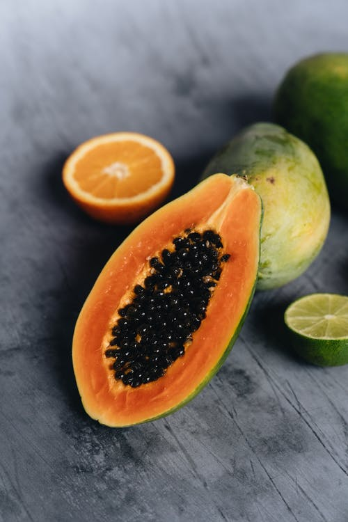 Photo Of Sliced Papaya Beside Sliced Lime