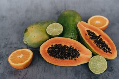 Close-Up Photo Of Sliced Papaya Beside Sliced Lime