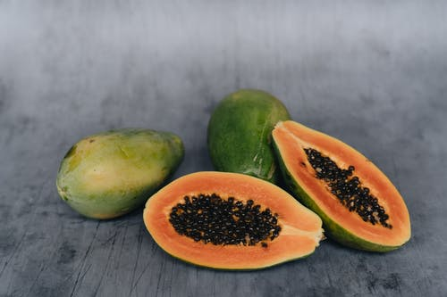 Close-Up Photo Of Sliced Papaya