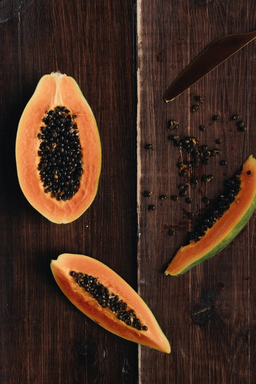 Photo Of Papaya On Top Of Wooden Surface