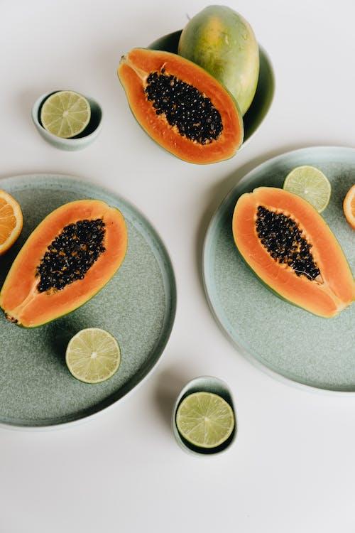 Photo Of Sliced Papaya Beside Sliced Lime