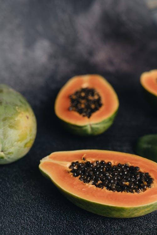 Close-Up Photo Of Sliced Papaya