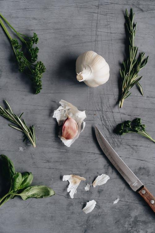 Photo Of Knife Near Garlic