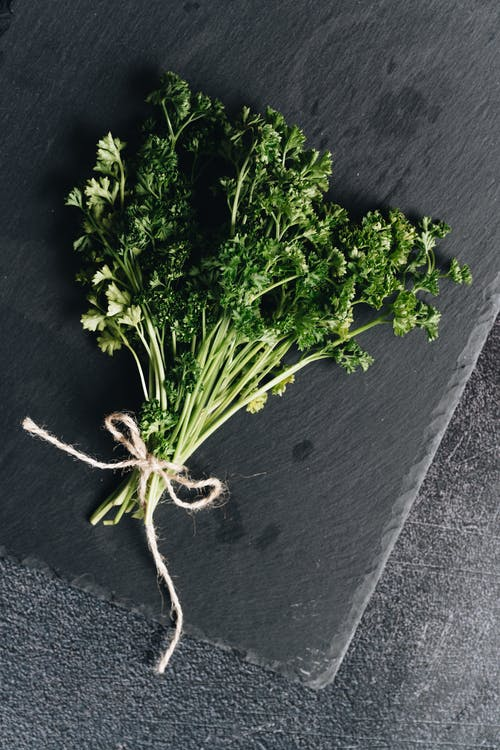 Photo Of Parsley On Top Of Stone Surface