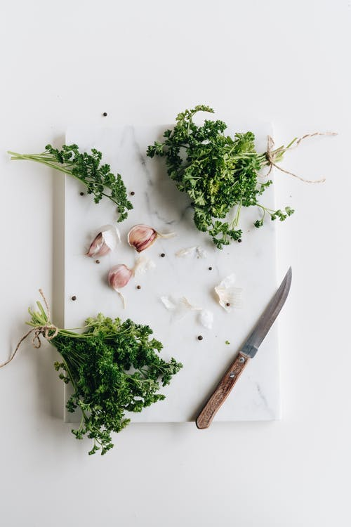 Photo Of Knife Near Herbs