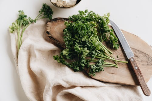 Photo Of Parsley On Top Of Wooden Chopping Board